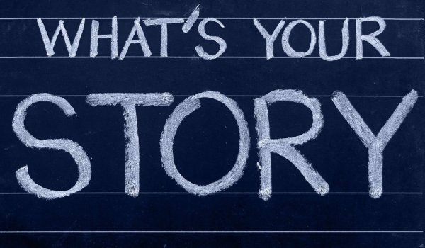 """Blackboard with the text """"What's Your Story?"""" written in chalk."""